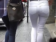 Candid butt in constricted white jeans
